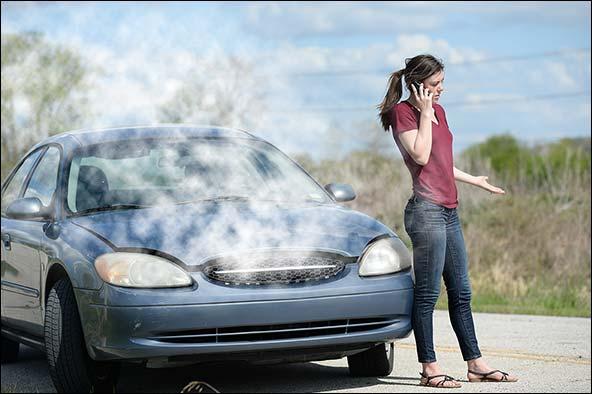 Engine overheating and girl on smart phone